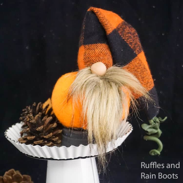 how to make a fall gnome in a pumpkin shape on a white stand on a black background