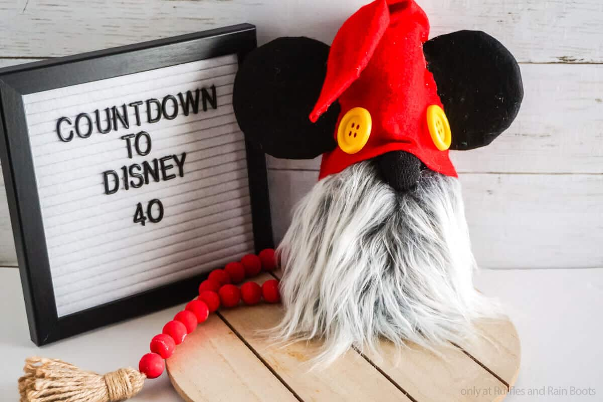 easy diy gnome with mickey ears with a letterboard with a countdown to disney vacation