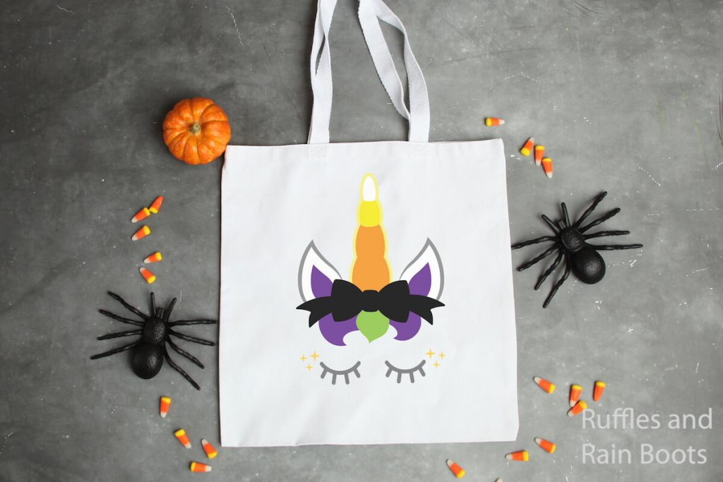 candy corn unicorn svg on a canvas bag