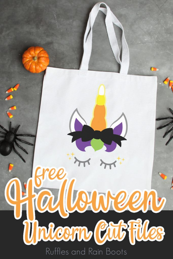 canvas bag with a unicorn cut file laying on a grey table with halloween toys scattered around with text which reads free halloween unicorn cut file