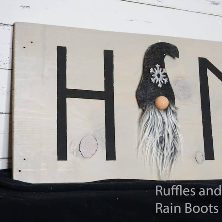 how to make a gnome home sign on a black table with a wood background