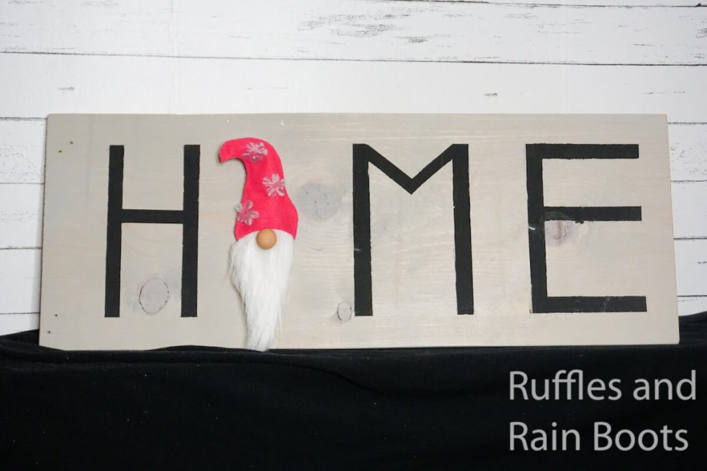 how to make a gnome sign on a black table in front of a wood background