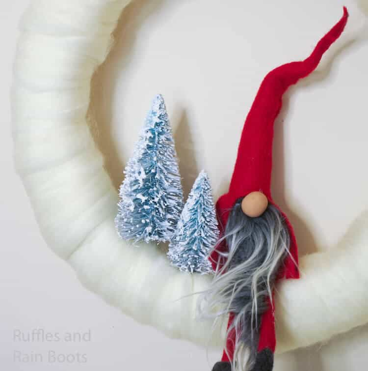 how to make a christmas wreath with a gnome on a white background