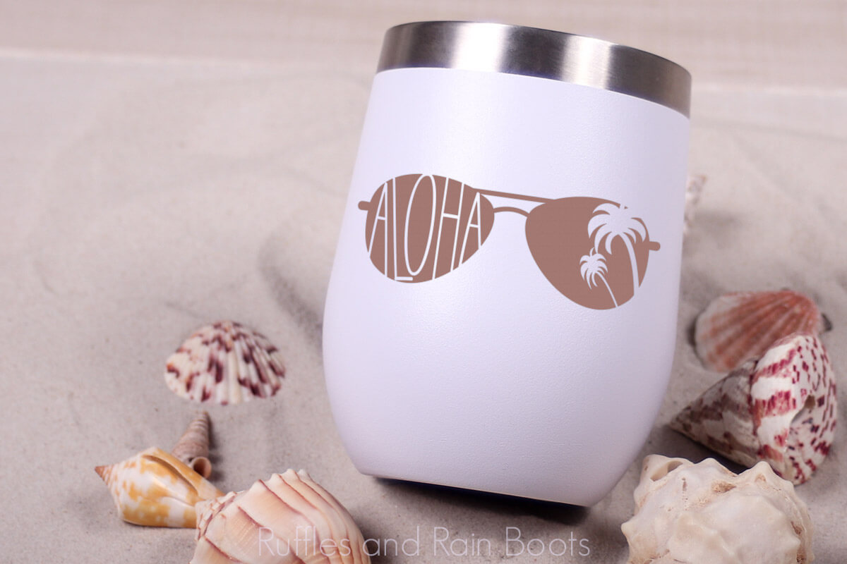 Tumbler Aloha SVG for Summer on a sandy beach with scattered shells
