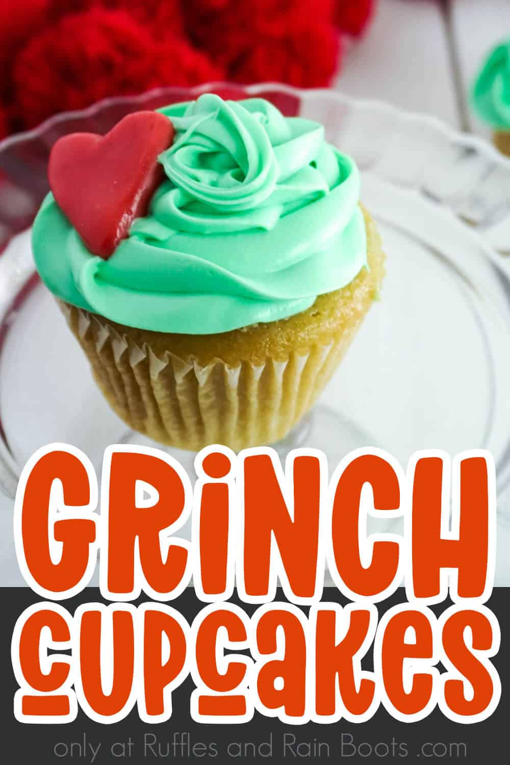closeup of grinch heart cupcakes with text which reads grinch cupcakes