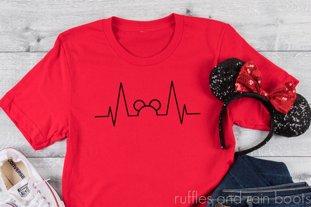 Mickey Ears Heartbeat SVG File for Disney Fans on a red tshirt with mickey ears on a white background