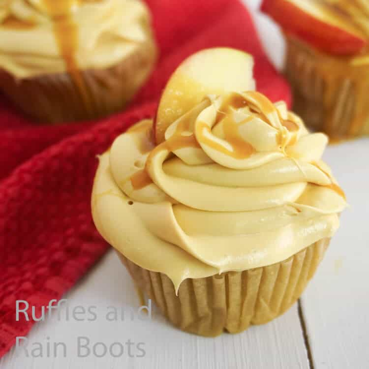 how to make fall cupcakes with caramel apple flavoring on a white wood table with a red linen