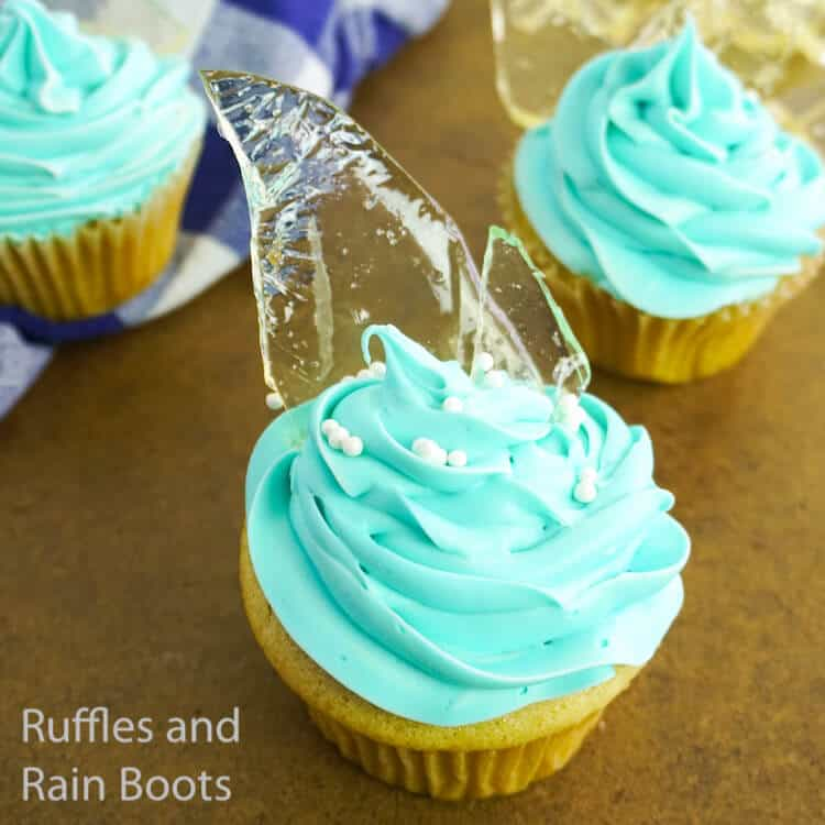 overhead view of how to make frozen cupcakes for a frozen party on a wood background