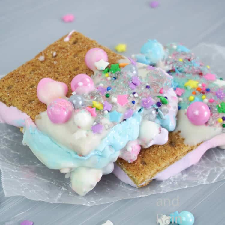 rainbow s'mores recipe on a grey table