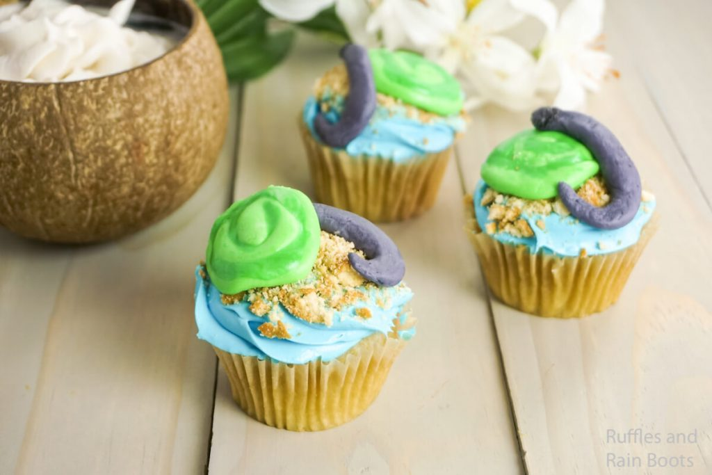how to make moana party cupcakes on a grey wood background