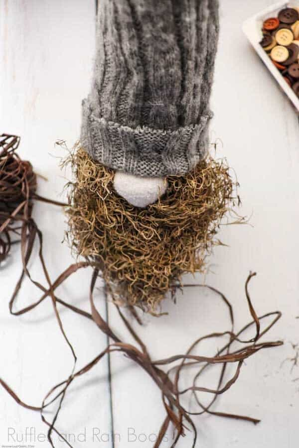 hot to make a farmhouse gnome with moss beard Step 9_ Add extra decorations for gnome