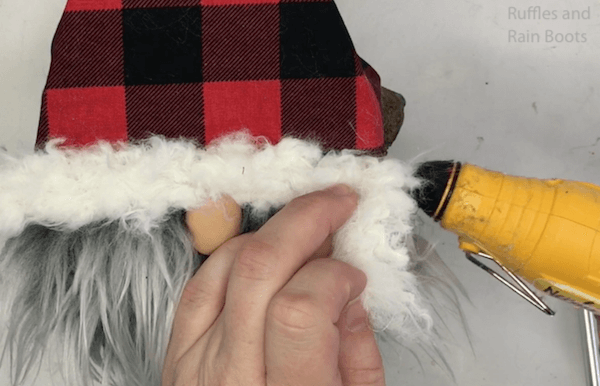 glueing on the fluffy part of the hat for the log gnome