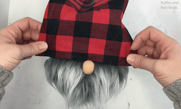 Gluing on the nose and hat for a log gnome