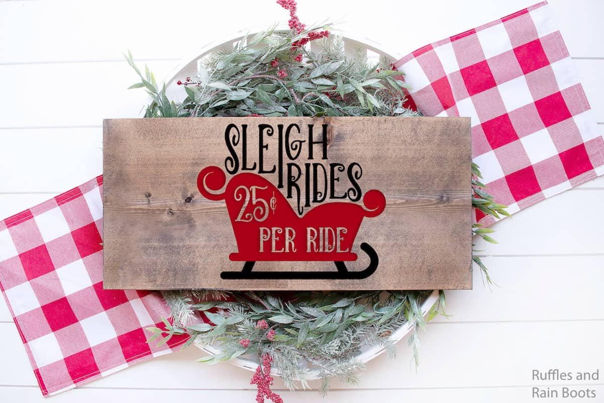 sleigh rides free Christmas SVG on wood sign