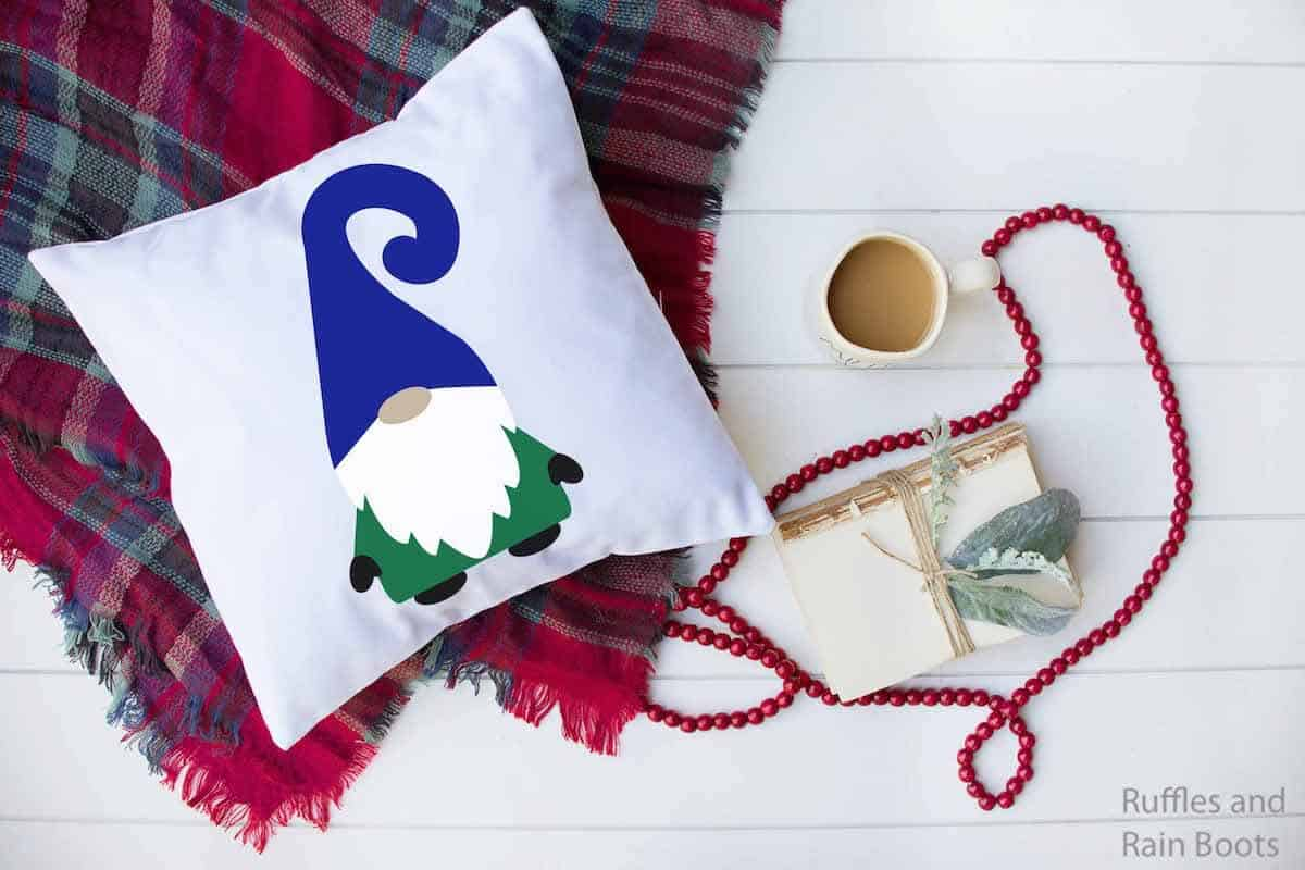 gnome free Christmas SVG on a pillow with a holiday plaid blanket