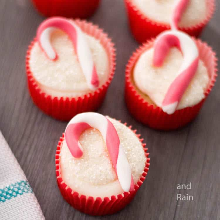 easy candy cane cupcakes for christmas on a dark wood table