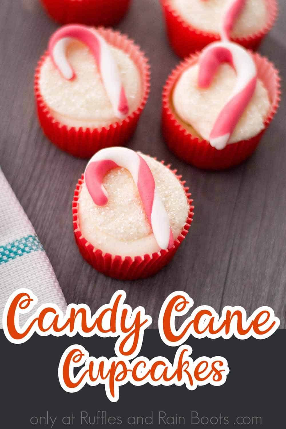 how to make christmas cupcakes on a brown table with text which reads candy cane cupcakes