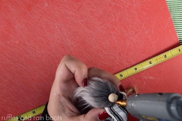 easy tutorial for a farmhouse gnome ornament step 11 glue hat to the top of the gnome nose