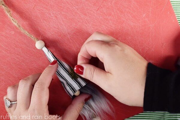 easy tutorial to make a farmhouse gnome ornament step 14 add decorations to the hat if desired