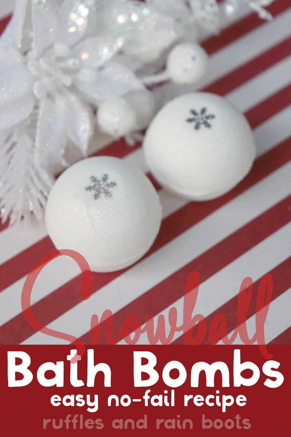 overhead view of two white ball bath bombs like snow with white christmas tree on a red and white background with text which reads snowball bath bombs easy no-fail recipe