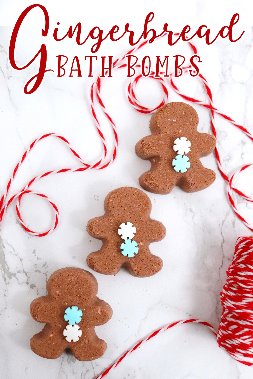 three gingerbready man bath bombs on a white background with red and white string with text which reads gingerbread bath bombs