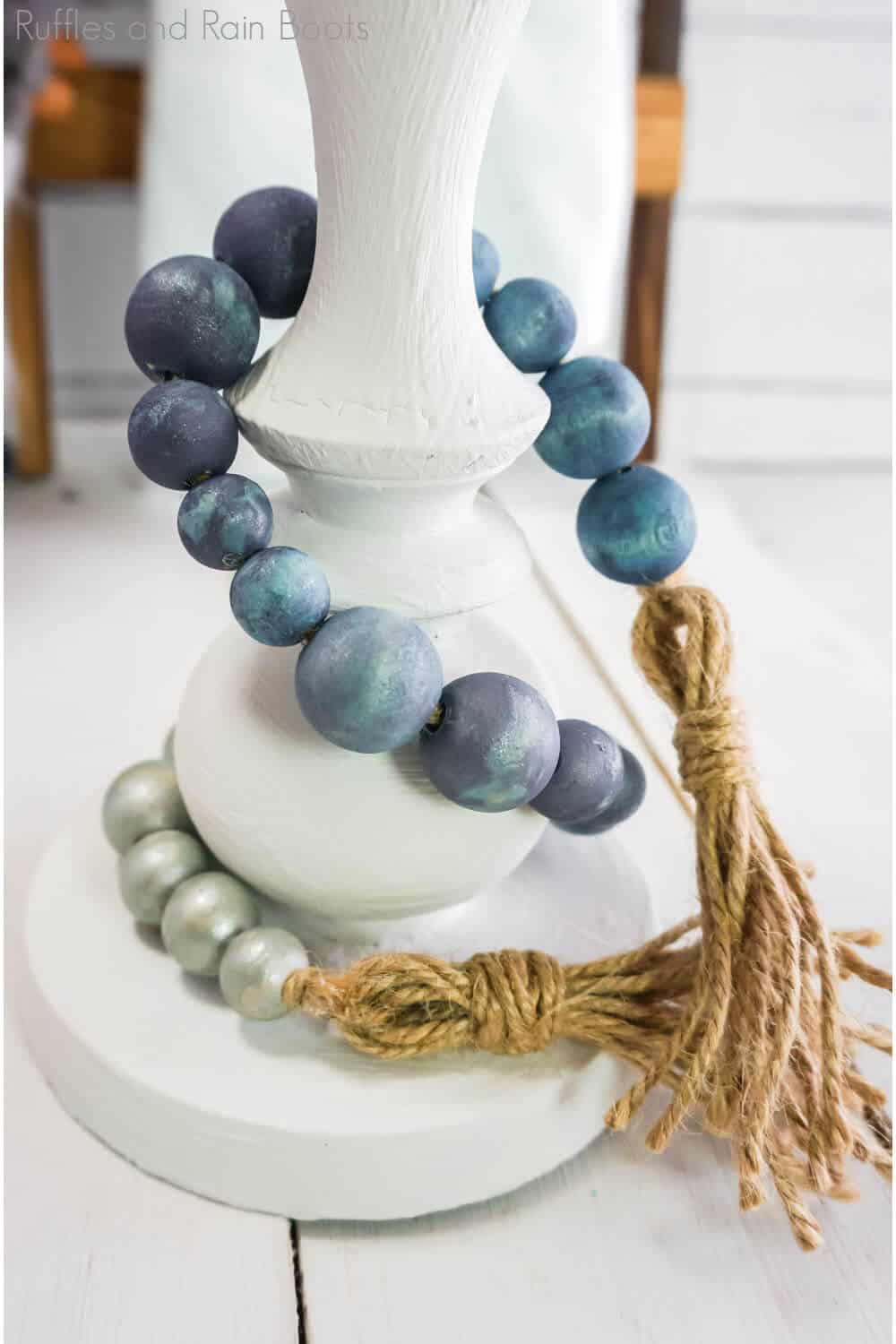 closeup of navy ombre farmhouse beads wrapped around a candle holder