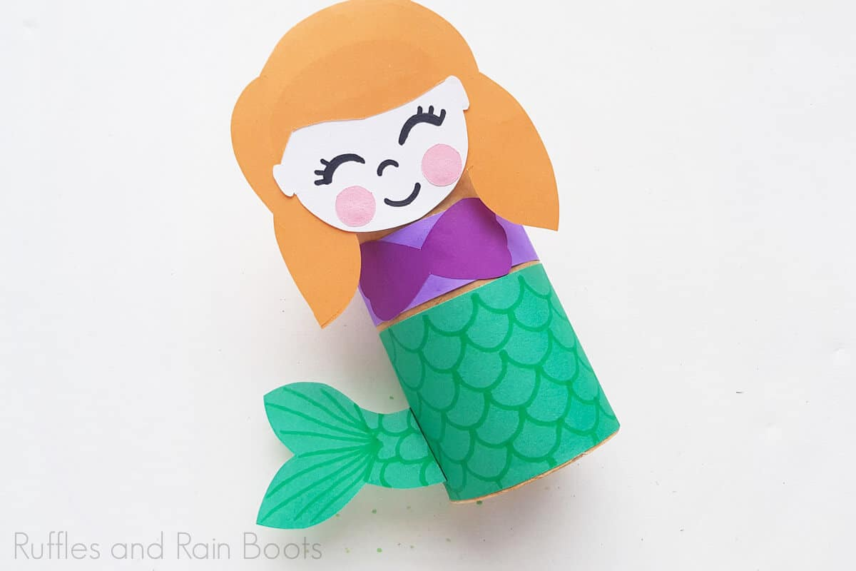 Completed princess ariel paper roll craft on a white background.