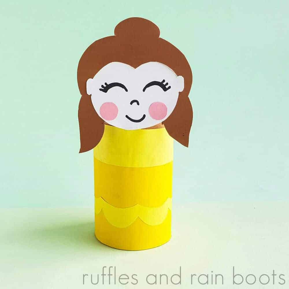 close up of princess Belle paper roll kid craft on green background