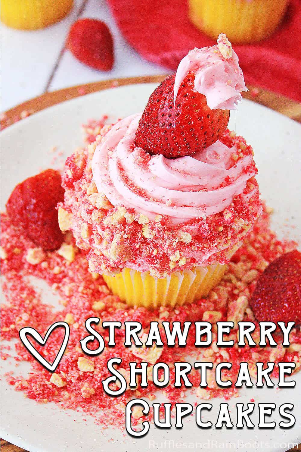 easy strawberries and cream cupcake decorating idea with text which reads strawberry shortcake cupcakes