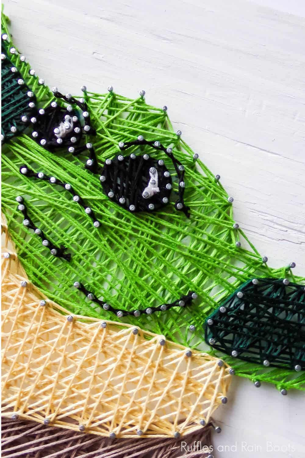 closeup of easy baby yoda string art project