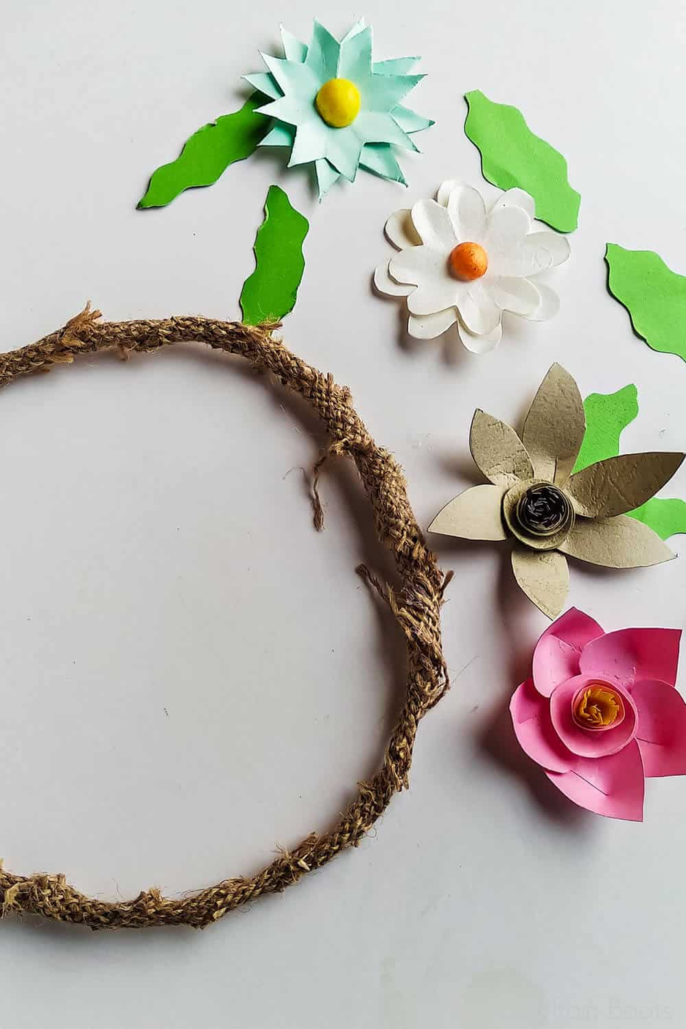 assembling a wreath of paper flowers