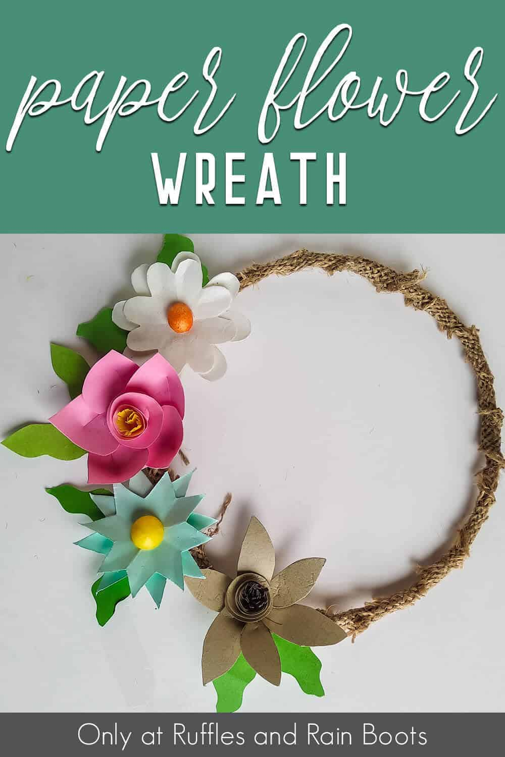 easy spring wreath made with paper flowers with text which reads paper flower wreath