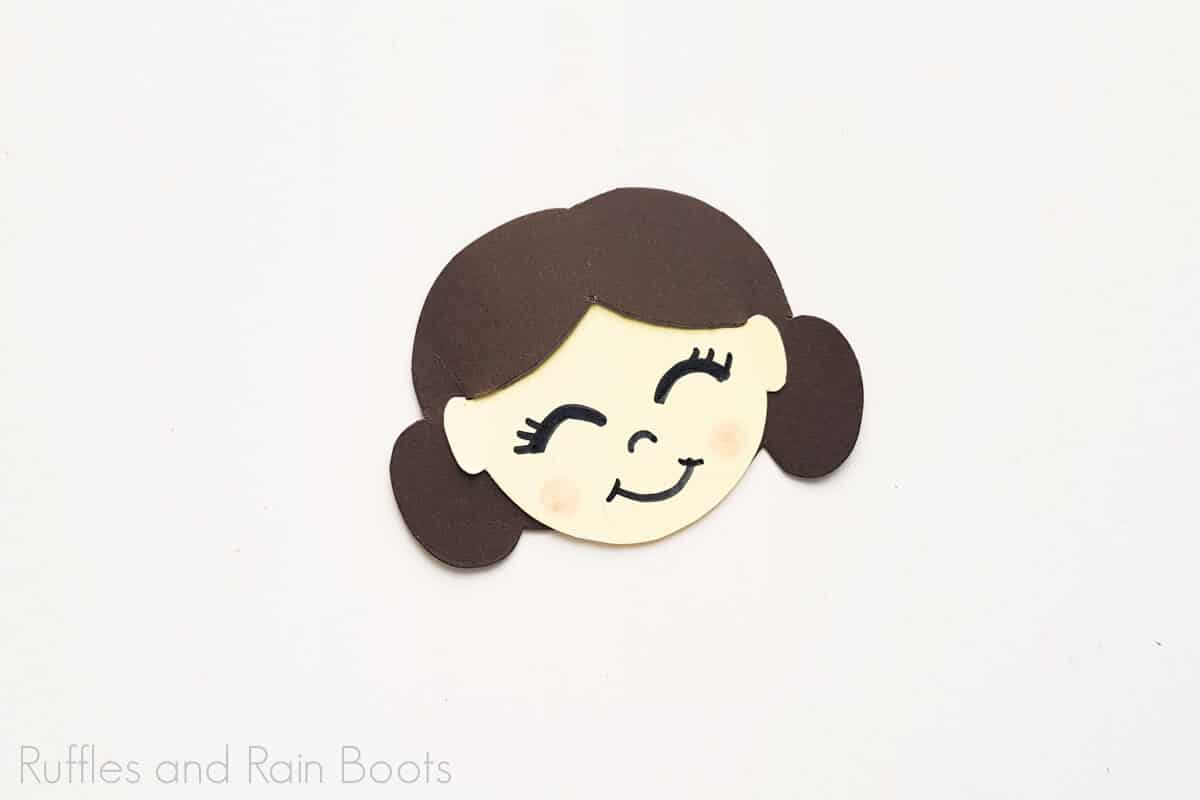 Process Image of a completed Princess Leia Paper Doll face with the features drawn on.