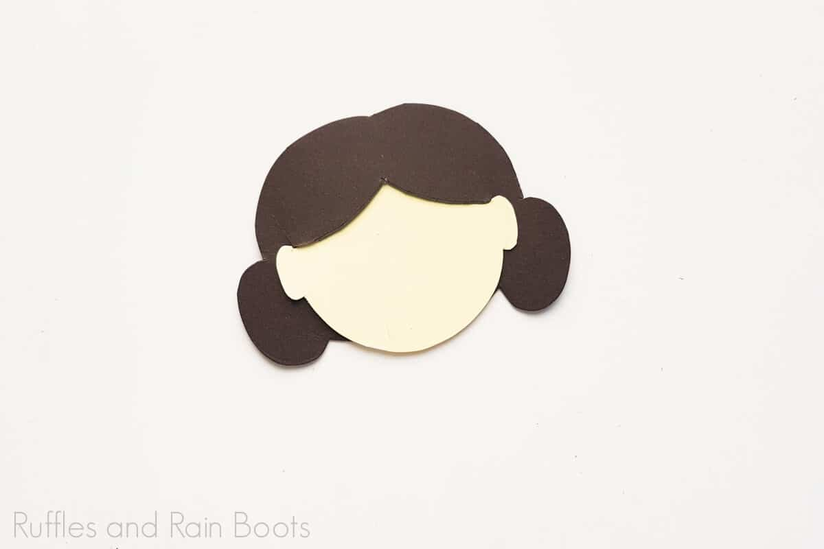 Process Image of paper craft Doll's Head on white background.