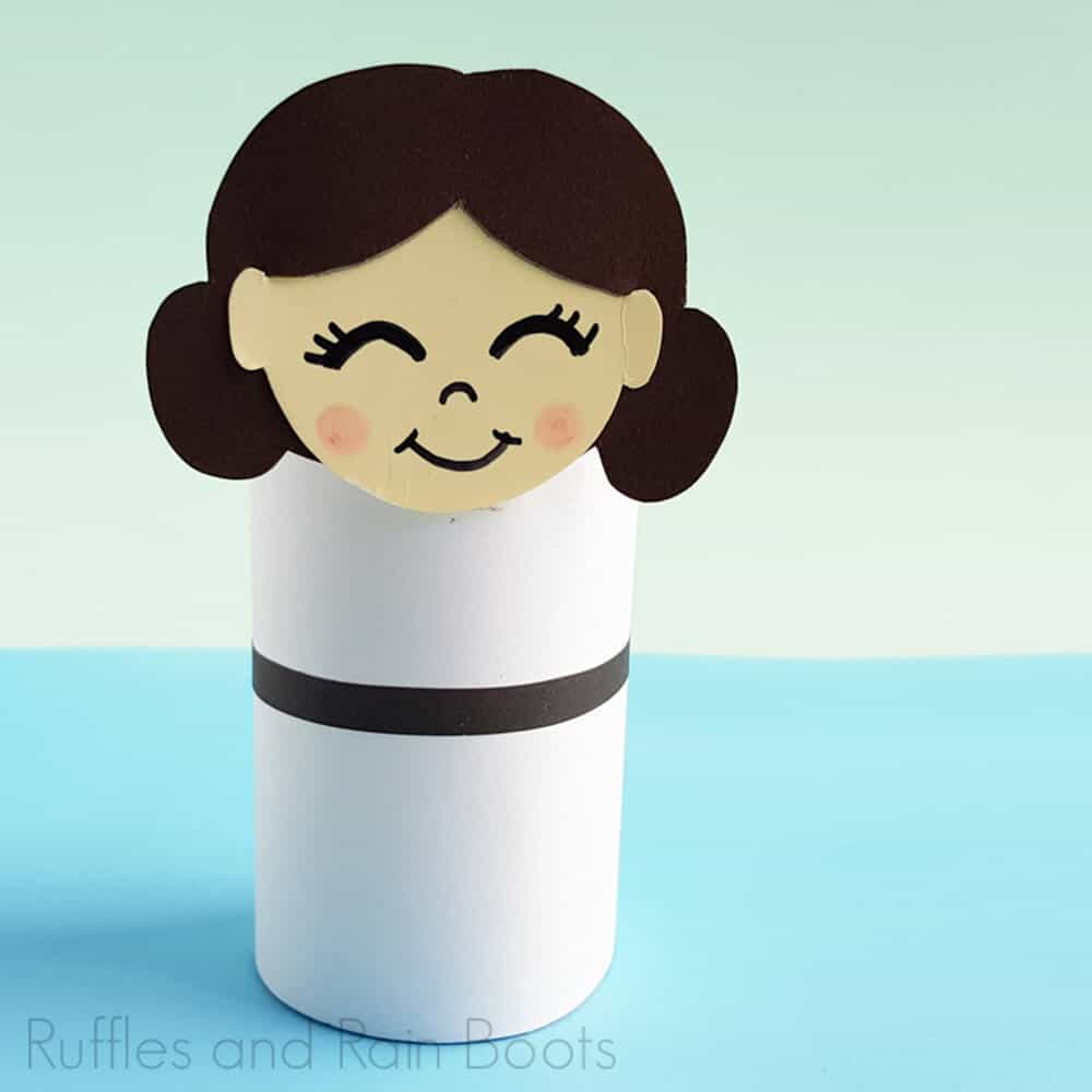 Square Image of Princess Leia Paper craft on light blue and light green background.