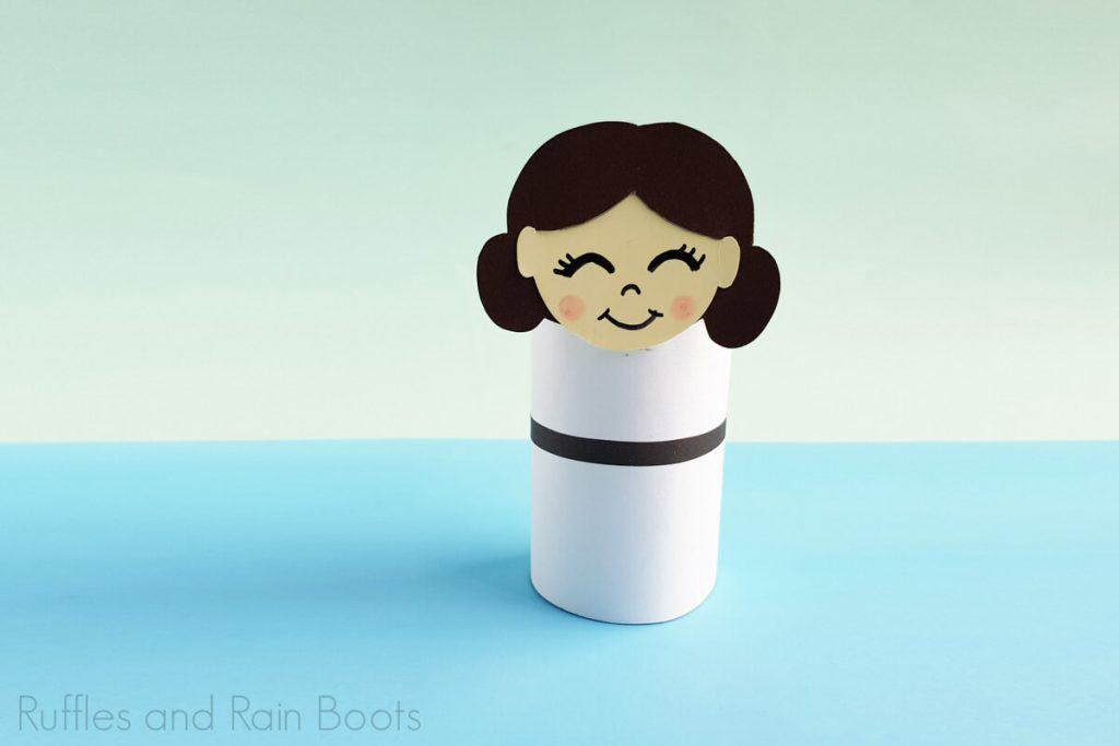 Horizontal Image of Princess Leia Paper Doll completed on a blue and green background