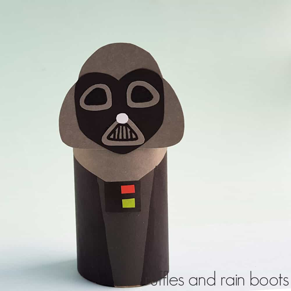 Square Image of a completed Darth Vader Paper Doll Craft on a light green background.