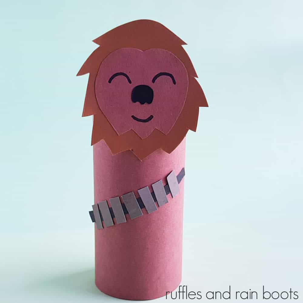 Square Image of Chewbacca paper craft on a light blue background.