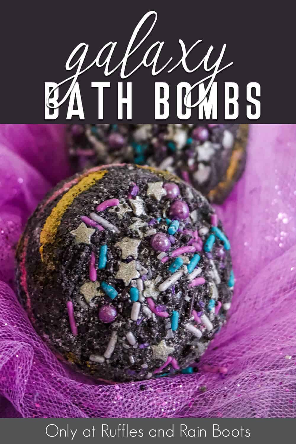 closeup of black bath bombs with star sprinkles with text which reads galaxy bath bombs