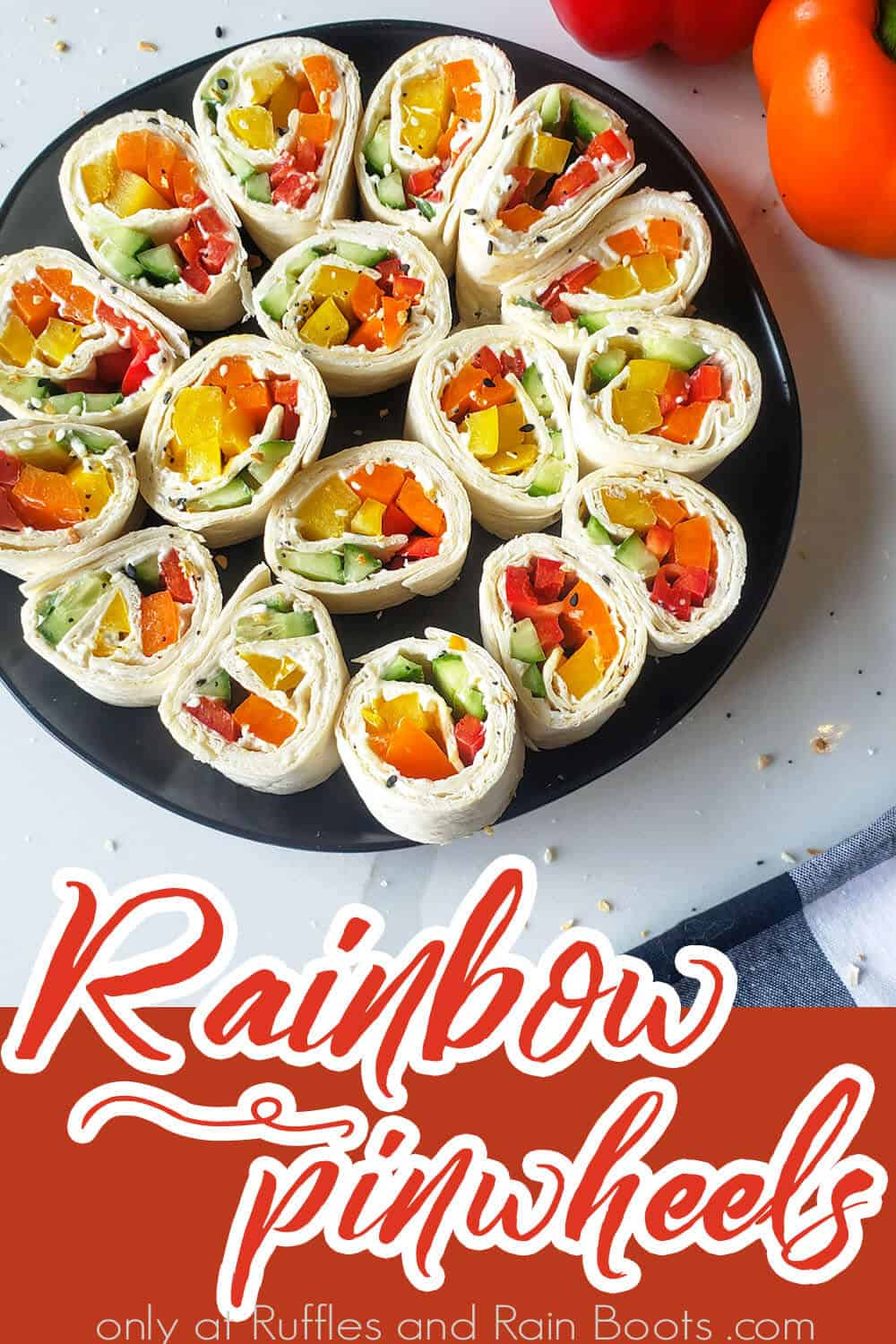 overhead view of easy rainbow pinwheel sandwich recipe with text which reads rainbow pinwheels