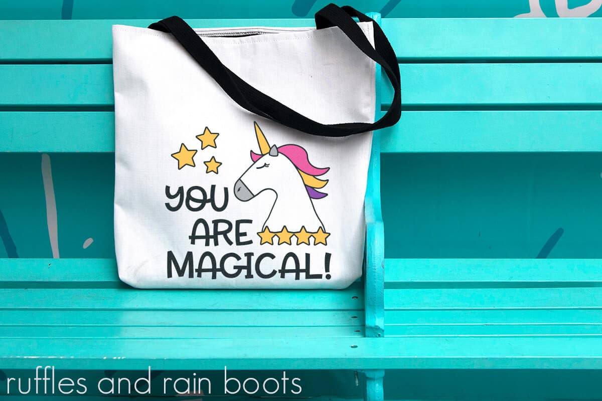 Unicorn SVG for Girl Vinyl Layering Magic on a canvas bag sitting on a bright bench