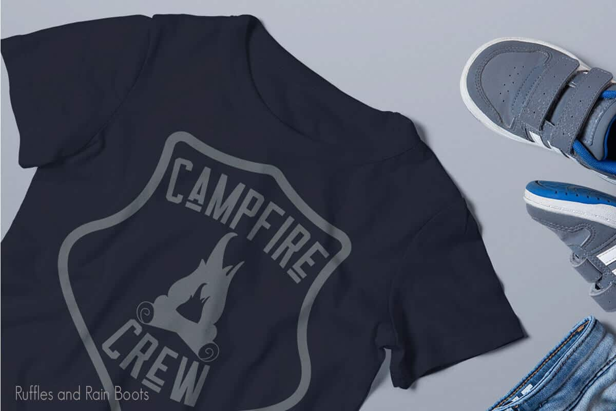 Campfire Crew SVG on a black tshirt on a white table