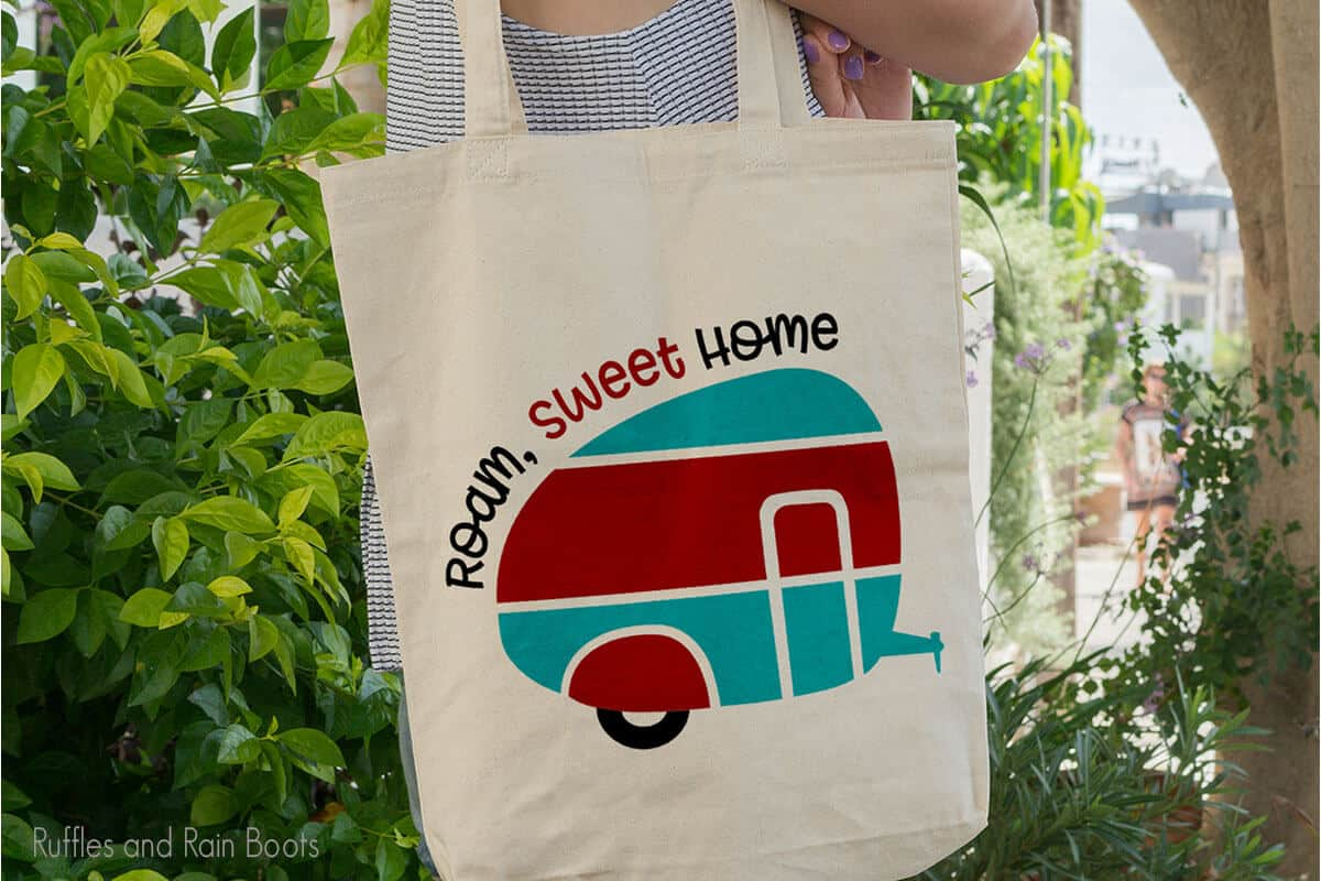 Camper RV SVG on a canvas bag held by a lady