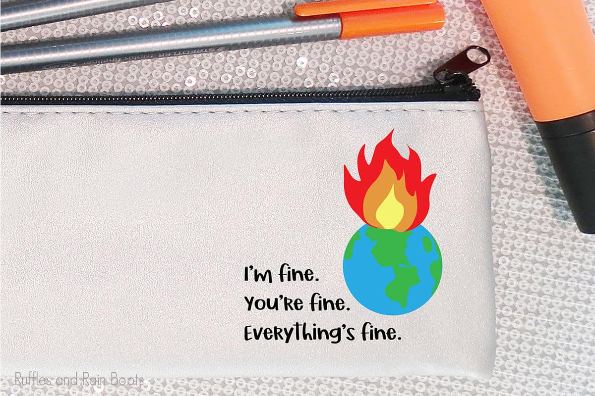 pencil bag with the I'm fine world on fire cut file on it