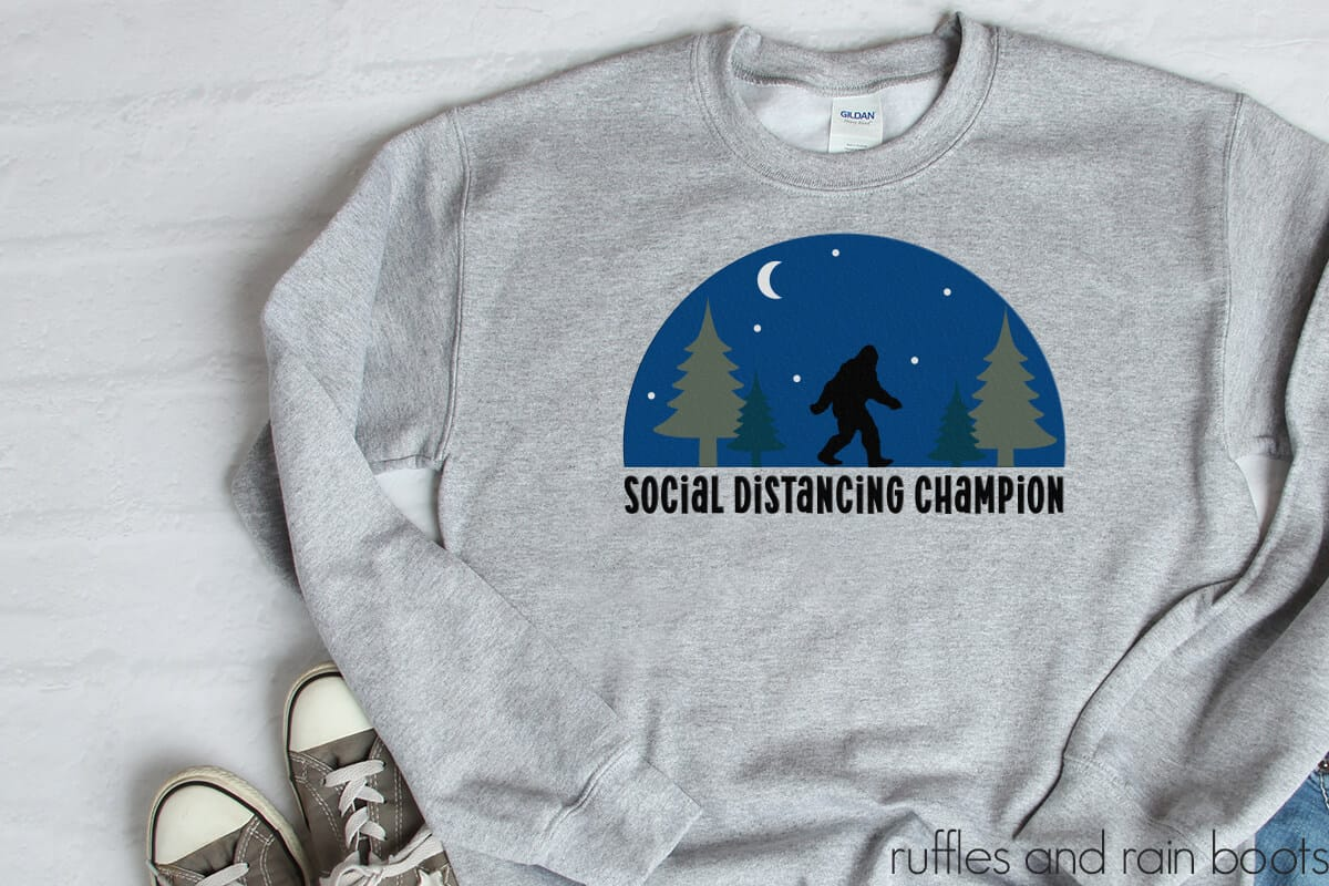 sweatshirt with the social distancing SVG on it with Sasquatch