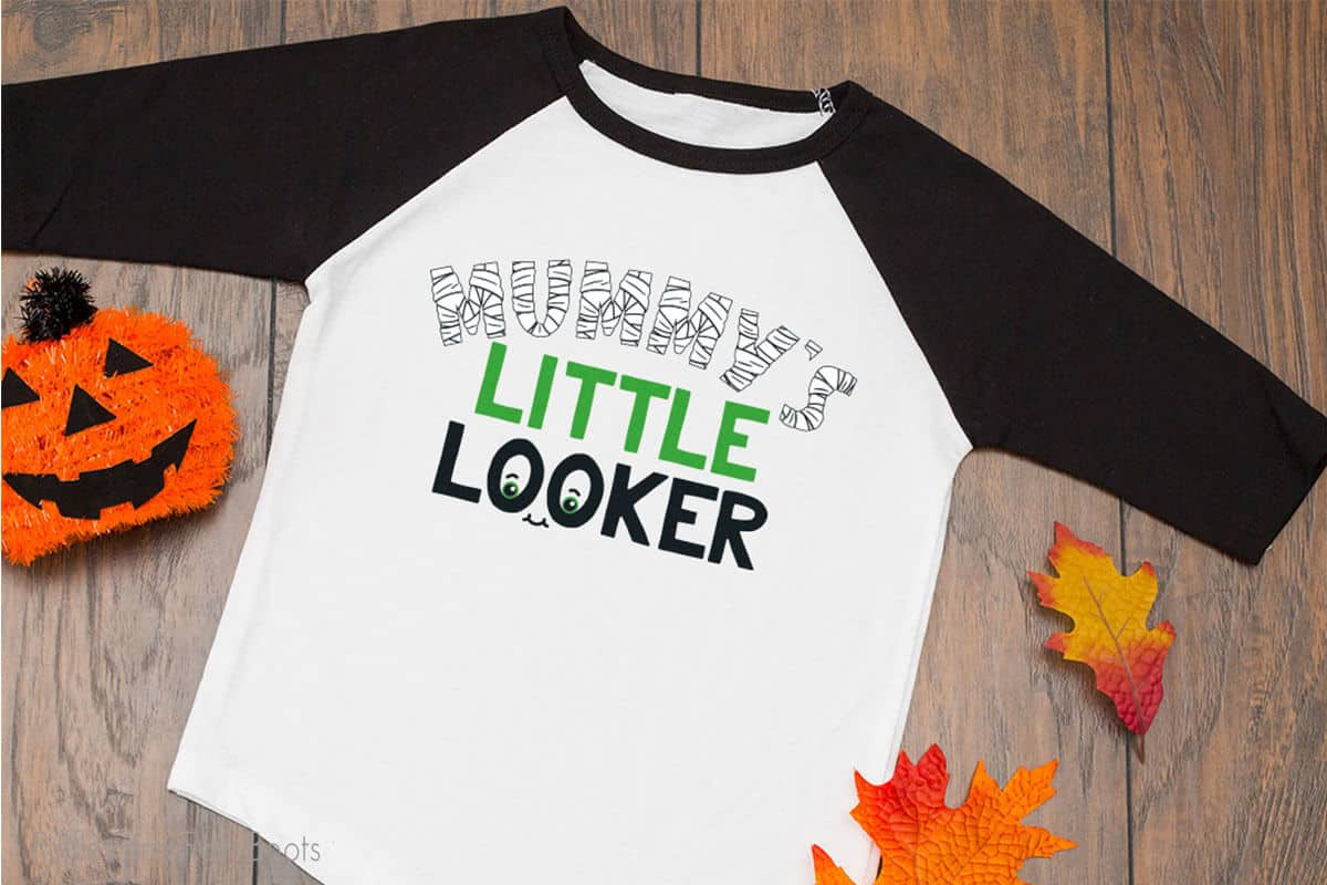 Mummy's LIttle Looker svg file for cricut on a tshirt on a table