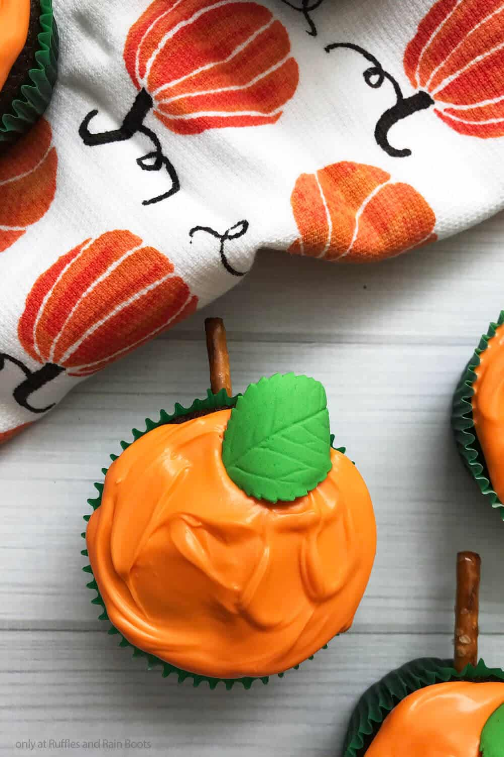overhead view of cupcake recipe for fall decorated like pumpkins