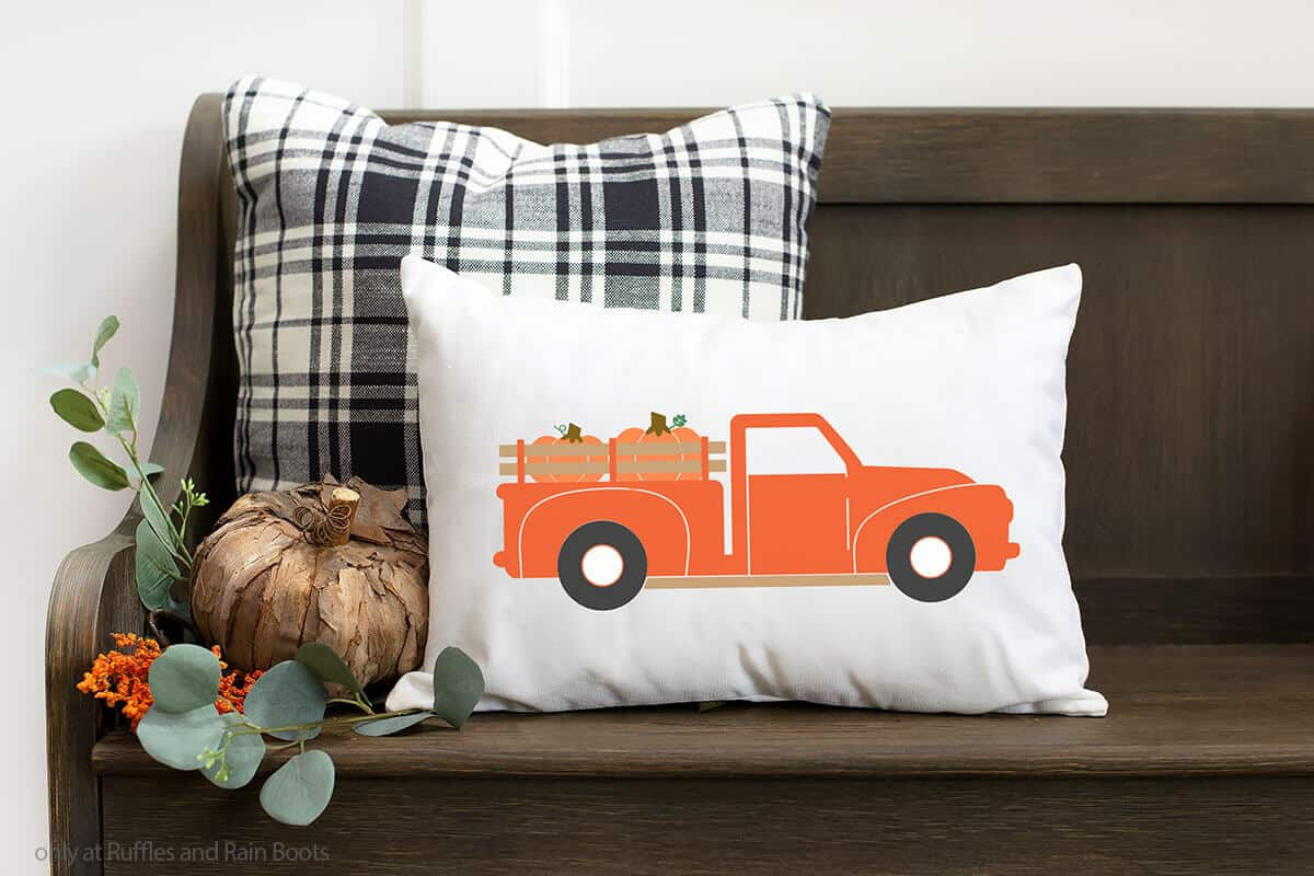 vintage truck for fall on a pillow sitting on a bench