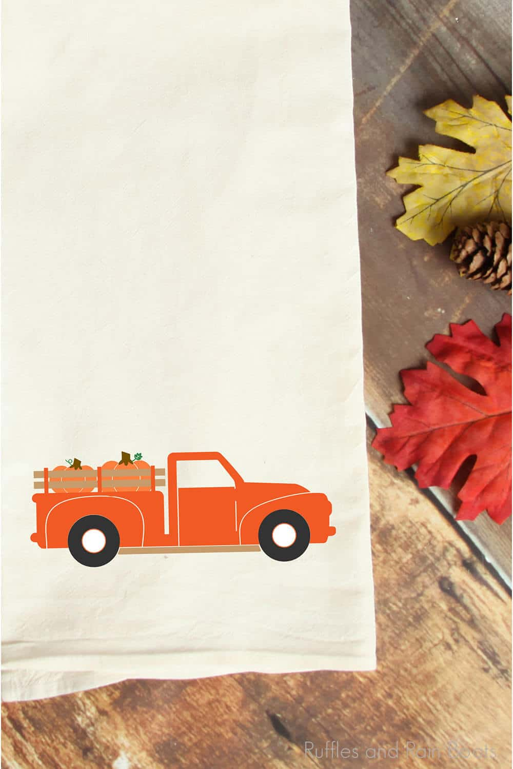 fall farm truck svg for cricut or silhouette on a tea towel on a wood table