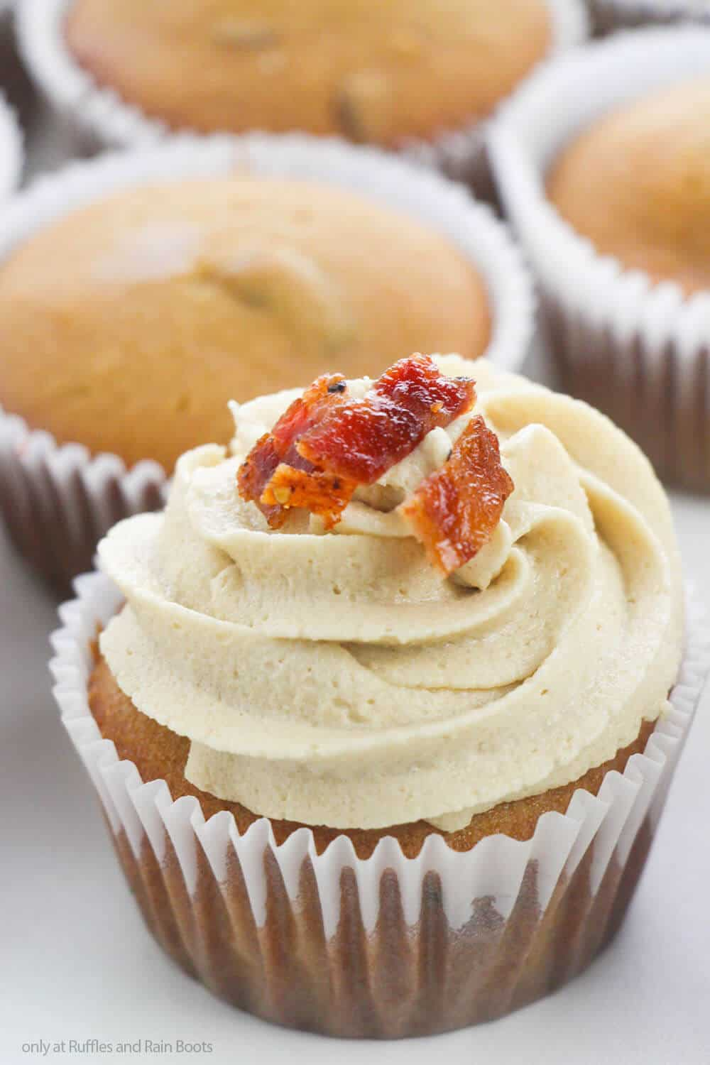 overhead view of easy cupcake with maple flavoring and bacon pieces on top